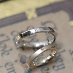 プラチナとシャンパンのウェーブの結婚指輪